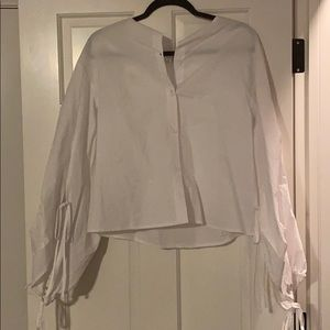 Brand new with tags, white blouse. Never worn.